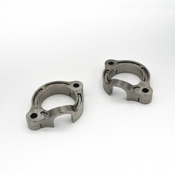 A picture of two Triumph 1200 exhaust flanges