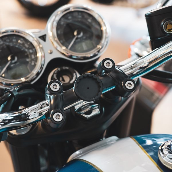 A picture of a T120 tech mount on a triumph motorcycle