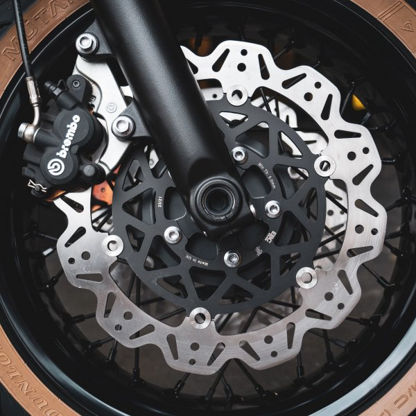 a picture of custom floating rotary brake discs for a Triumph motorcycle